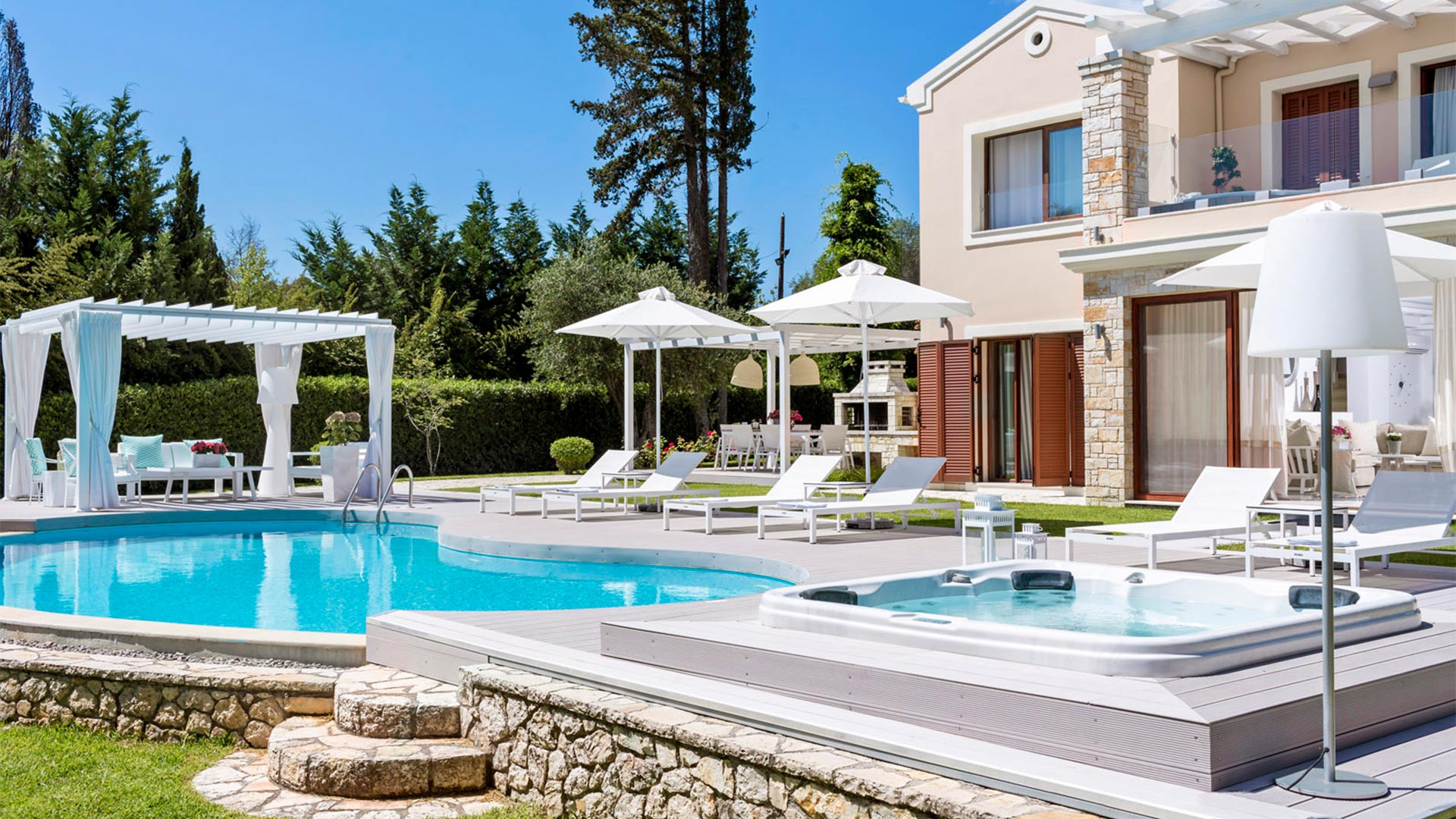 Relax by the pool at Ikos Olivia, Greece