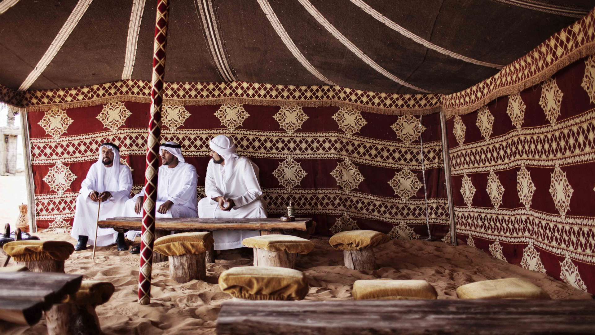 Three men in a traditional tent in Dubai