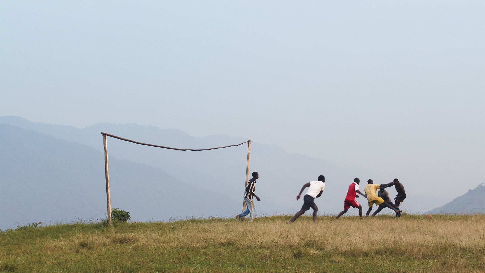 Playing football on the edge of Bwindi Impenetrable Forest, Uganda