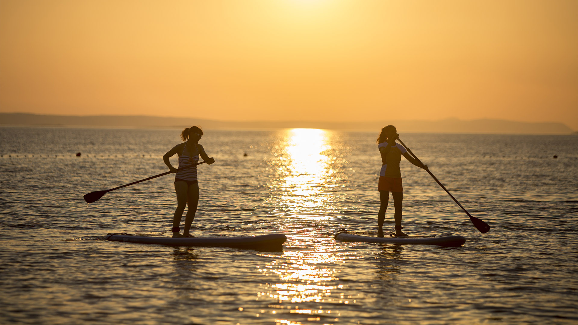 Standup paddle boarding with Neilson at Alana Beach Club, Croatia