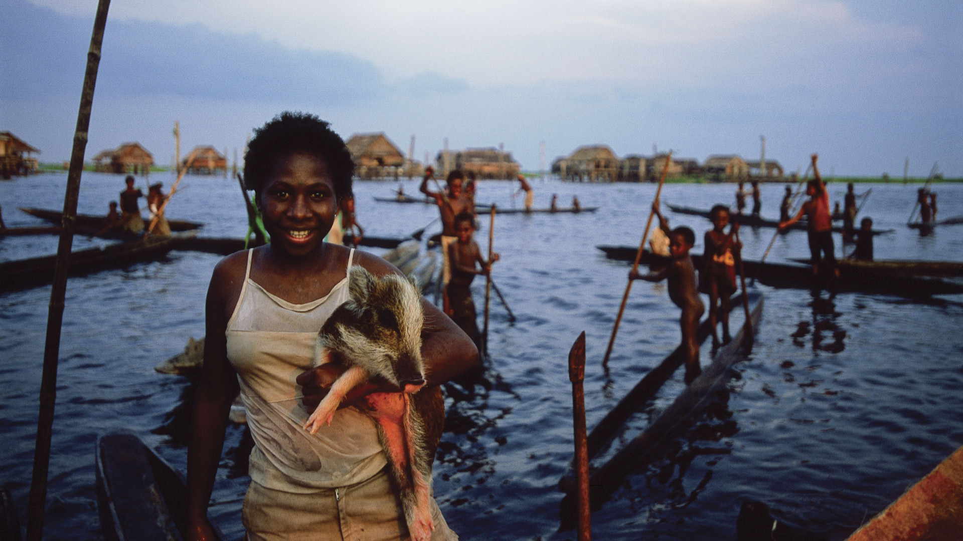A woman by a lake at the mouth of the Sepik river