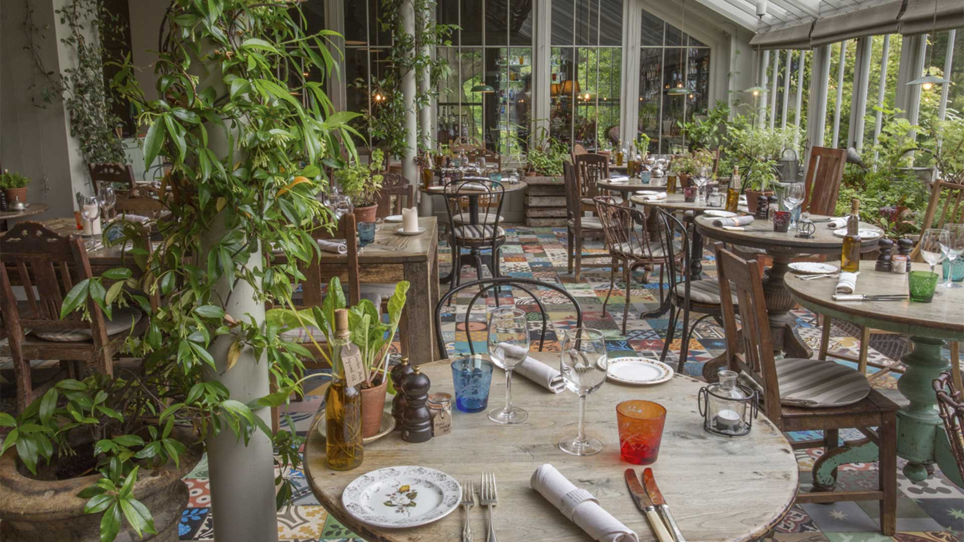 The conservatory dining room at The Pig at Brockenhurst, in the New Forest
