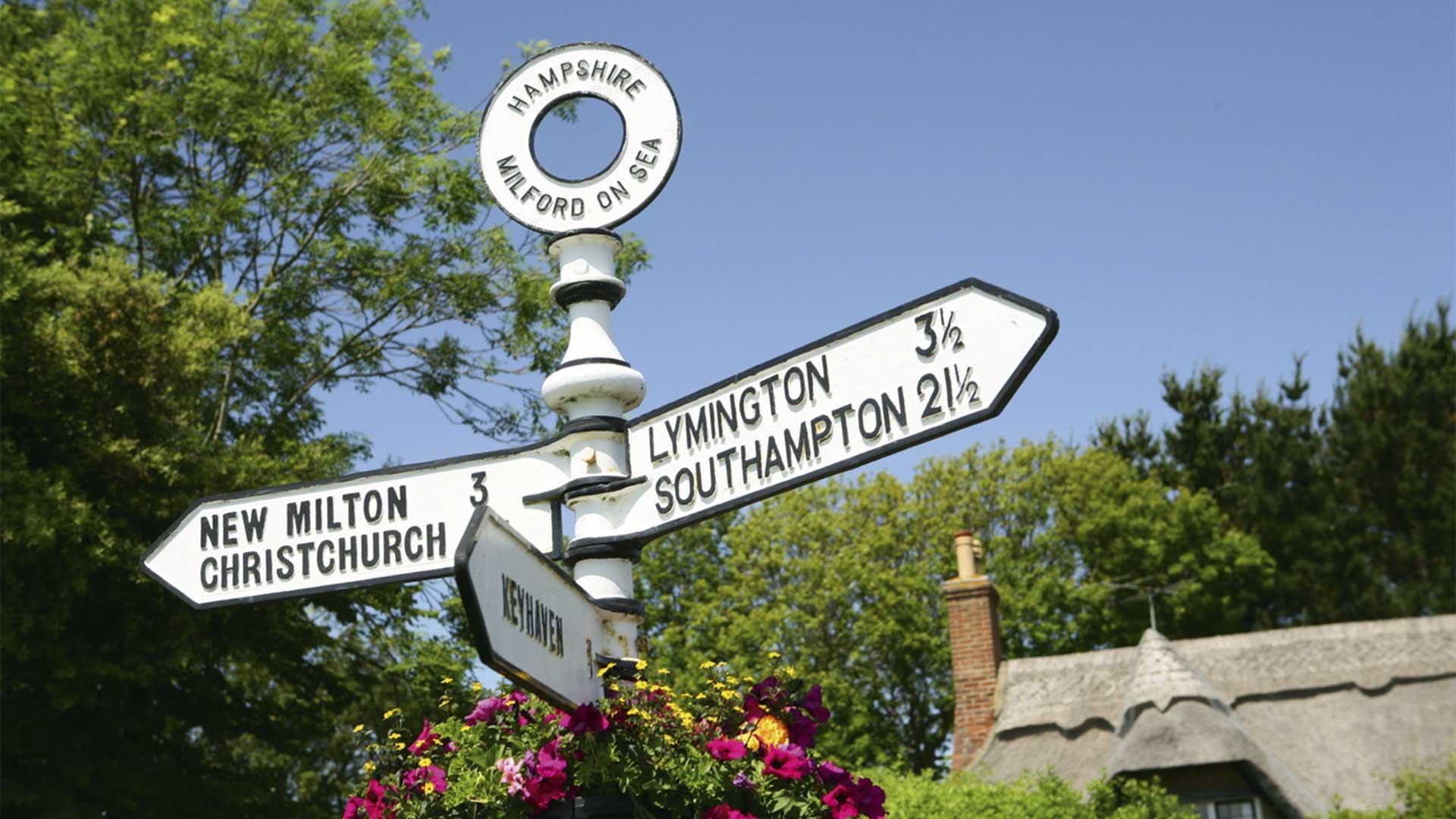 Signpost pointing to Lymington in the New Forest, UK