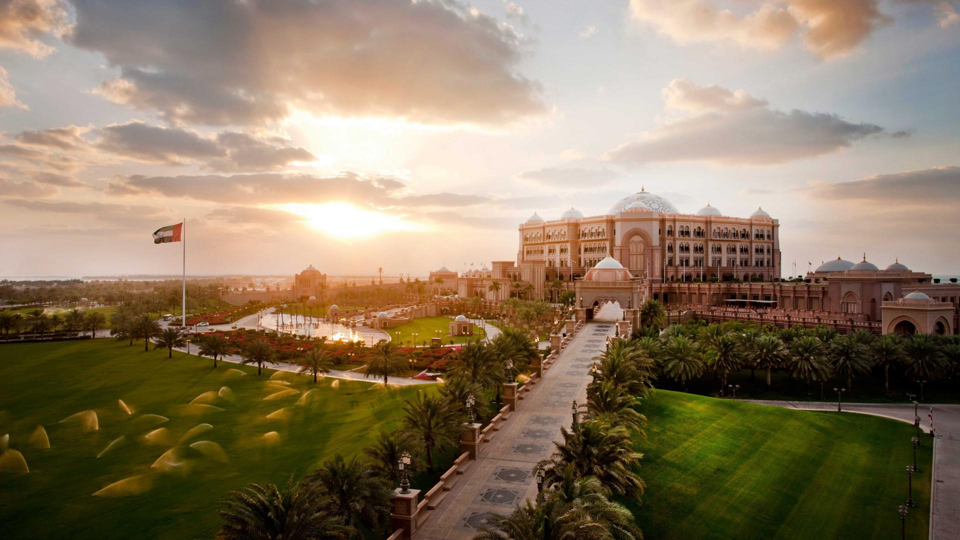 Exterior of Kempinski Emirates Palace in Abu Dhabi, UAE at sunset