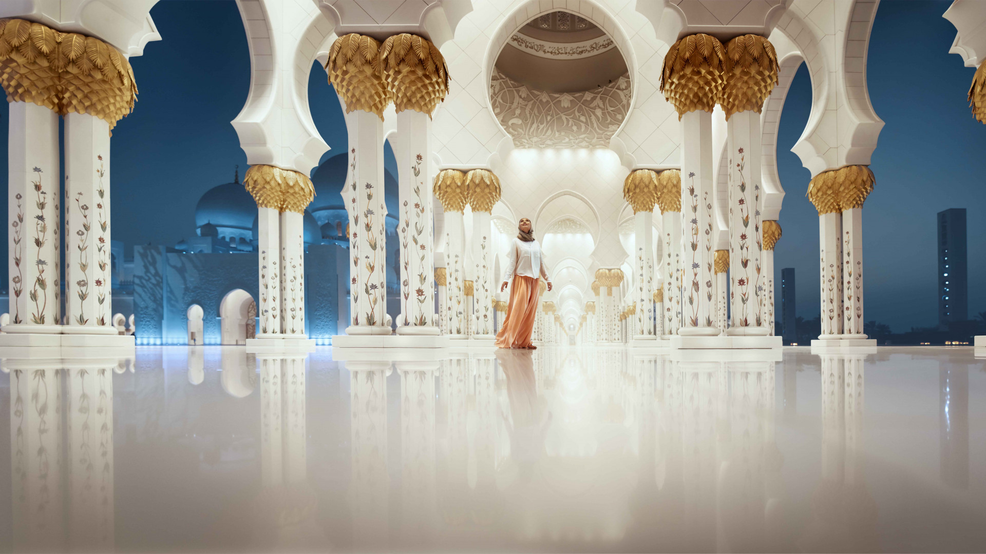 Woman looking at Sheikh Zayed Grand Mosque in Abu Dhabi, UAE