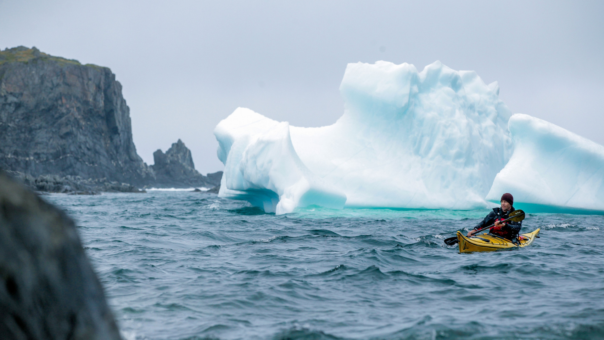 Kayaking past icebergs in Canada