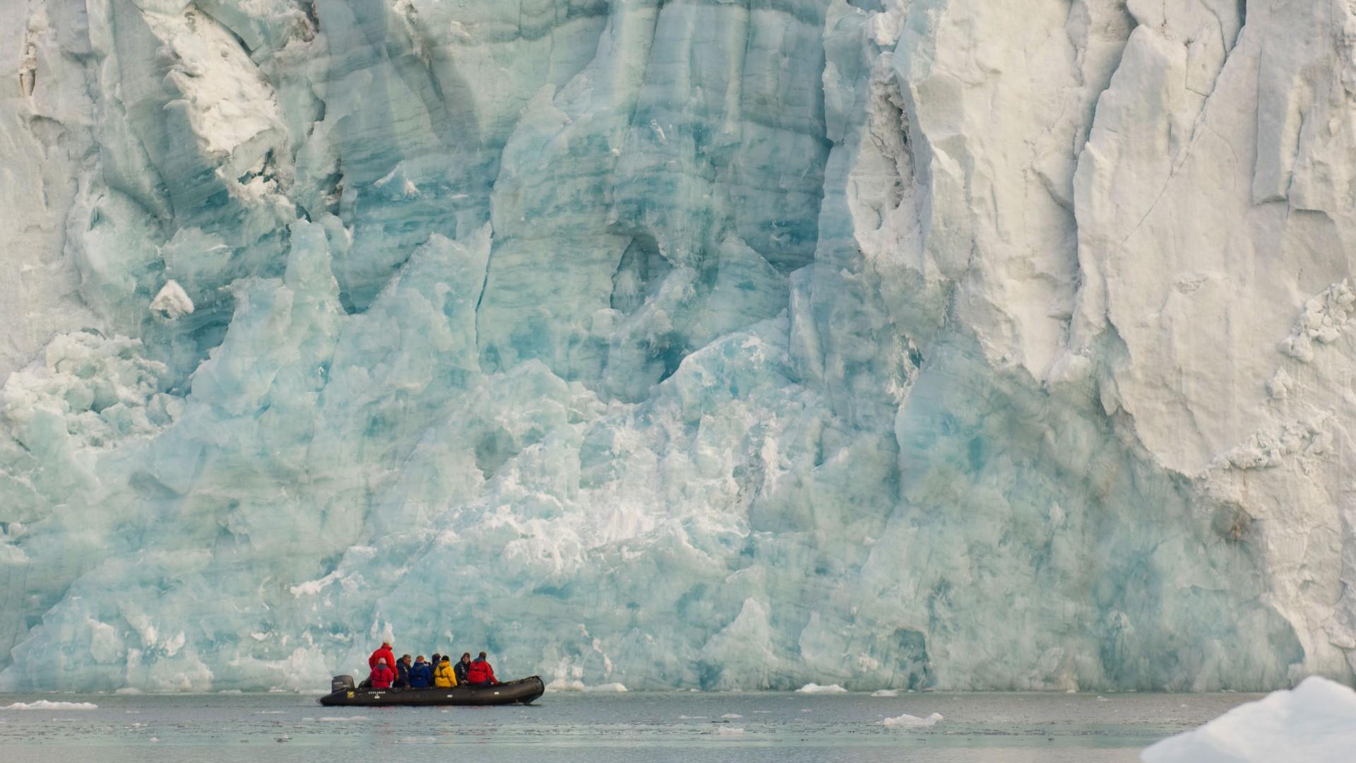 Zodiac in front of the Samarinbreen Glacier, Hornsund, Spitsbergen Island, Svalbard Archipelago, Norway