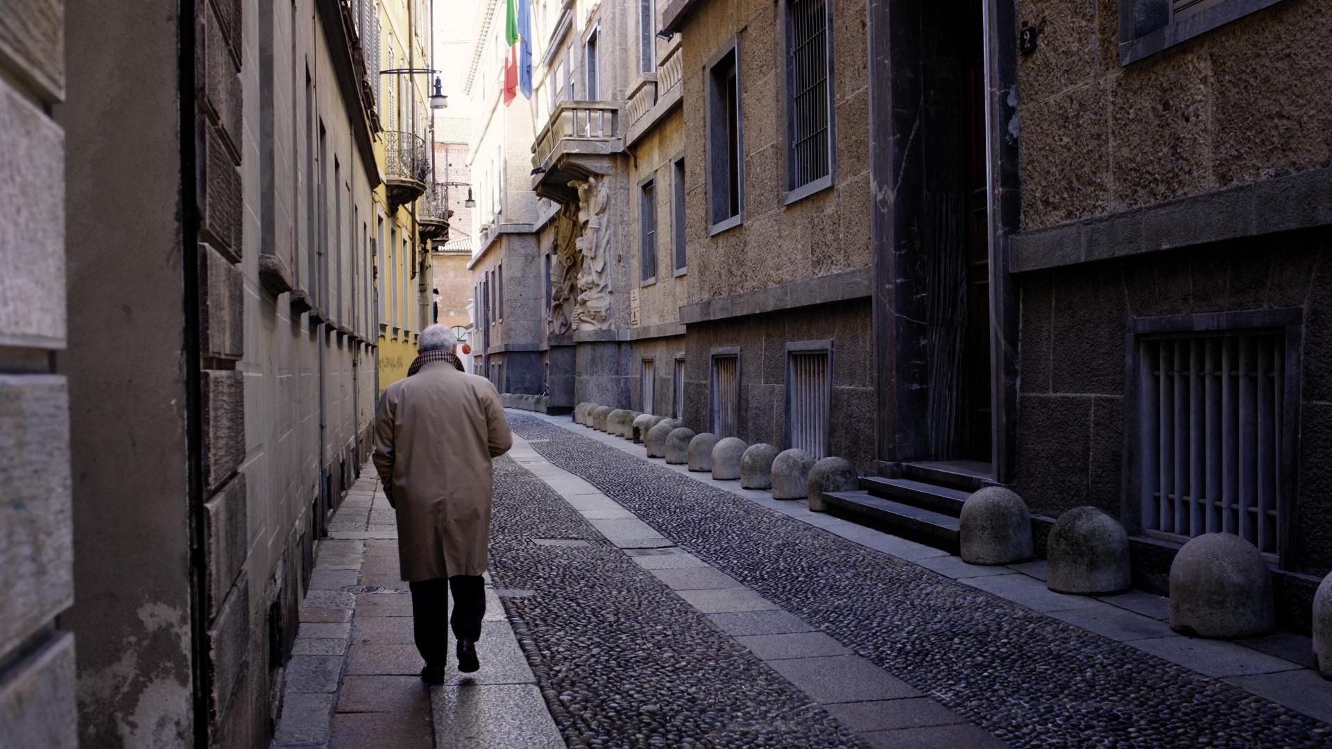 A man walking through Milan in the winter