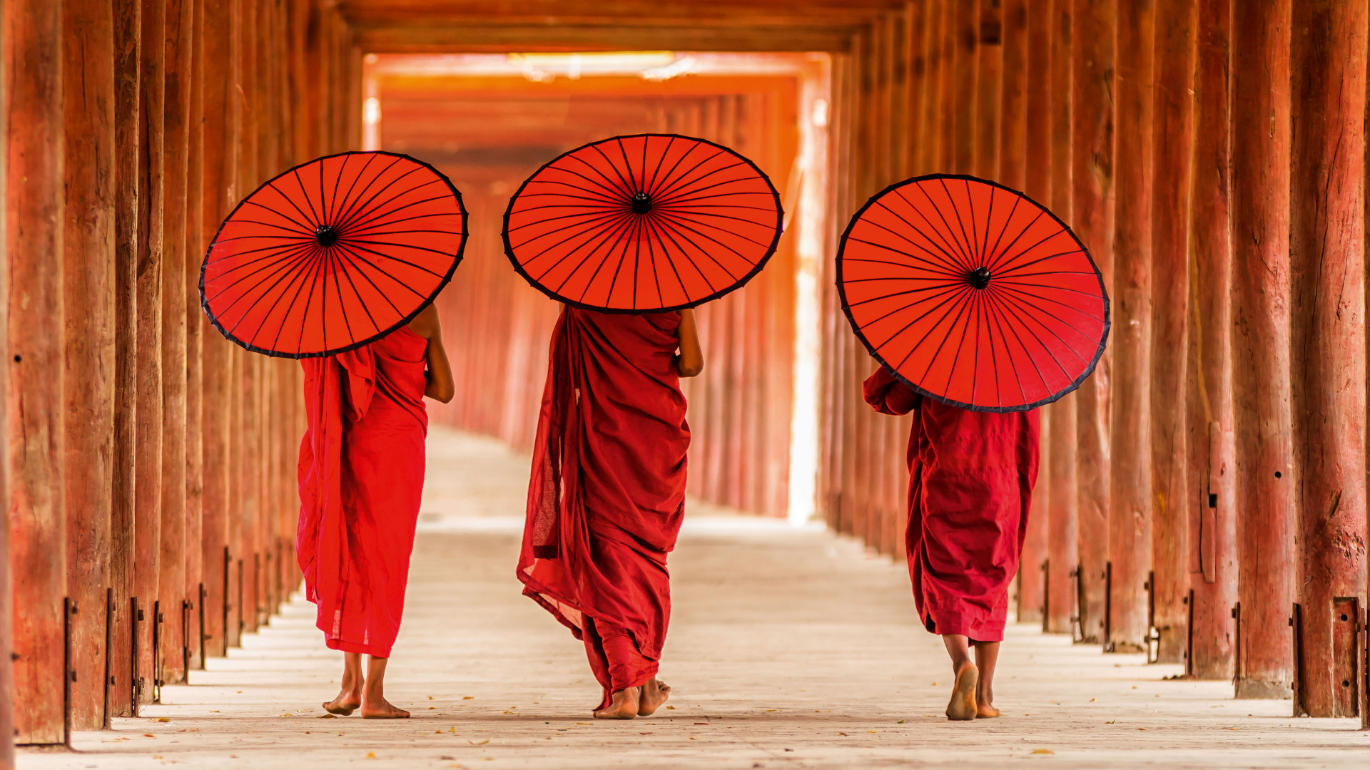 People walking with umbrellas in Myanmar