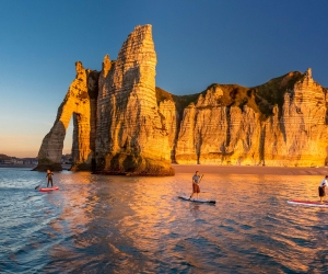 Normandy: Etretat beach with stand up paddleboarders