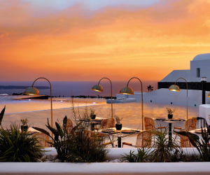 Sunset over the pool at Santo Maris Oia