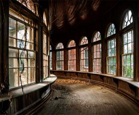 Curved interior bridge of abandoned American psychiatric hospital