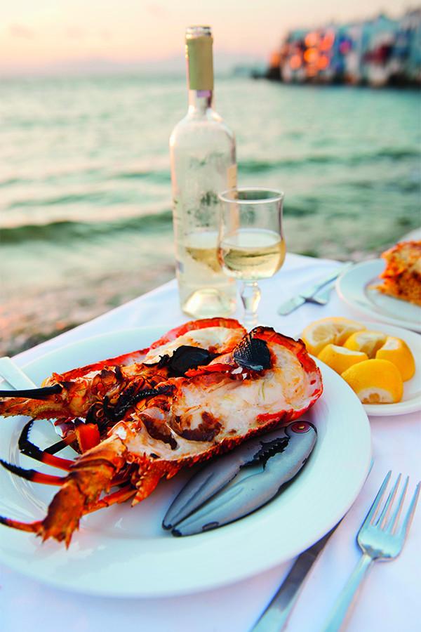 Eating lobster alfresco in Mykonos, Greece