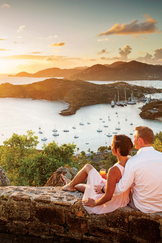 Couple overlooking Falmouth harbour in Antigua