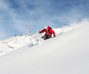 Skiier takes on the slopes in Kitzbuhel