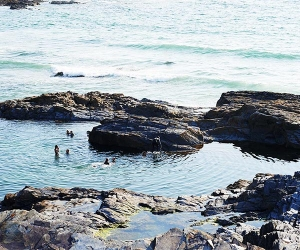 Wild swimming on the coast of Cornwall, UK