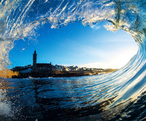 Through-wave view of Porthleven, Cornwall