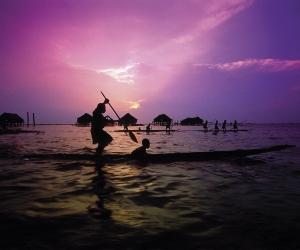 A canoe padler at sunset